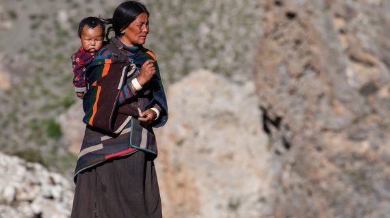 Dolpa woman and her baby in the sun