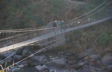 Crossing Langtang Khola (river)